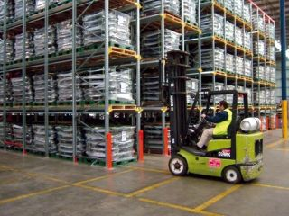 Drive-in pallet racks in a warehouse with forklift.