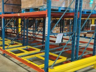 Push back pallet racking in warehouse.
