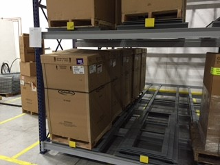 Push back pallet racks with boxes.